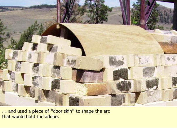 ". . and used a piece of ""door skin"" to shape the arc that would hold the adobe."
