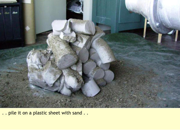 . . pile it on a plastic sheet with sand . .