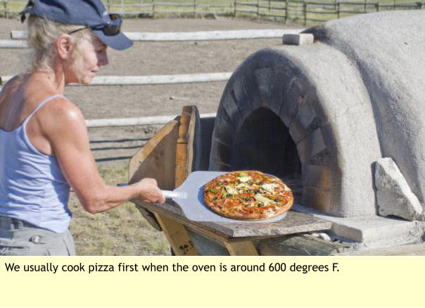 We usually cook pizza first when the oven is around 600 degrees F.